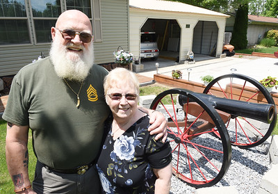 Vietnam veteran Jack Tagmyer and his wife, Kathy, stand in front the replica  of a cannon Jack built. Harold Aughton/Butler Eagle