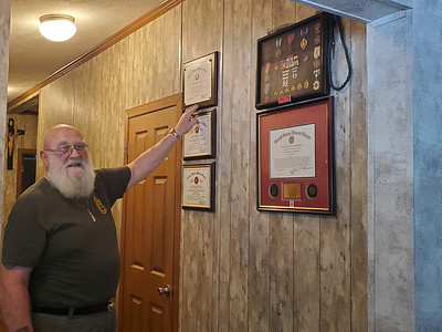 EDDIE TRIZZINO/BUTLER EAGLEJack Tagmyer keeps his honors and recognitions on a wall in his home.