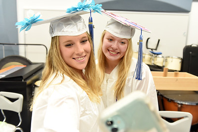 Seniors Brogan Armagost and Emily Bolles capture a moment prior to Allegheny Clarion Valley High School's 2021 graduation ceremony. Harold Aughton/Butler Eagle
