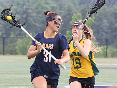 Mars' Lydia Toparli fights off a challenge from Blackhawk's Felicia Young  in Mars 10-3 WPIAL Championship win over Blackhawk Tuesday at Robert Morris University. Seb Foltz/Butler Eagle 05/26/21