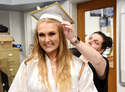 Senior Kenzy Kellogg receives a little help with her graduation cap from substitute teacher, Jessica Jordan, prior to Allegheny Clarion Valley High School's 2021 graduation. Harold Aughton/Butler Eagle.