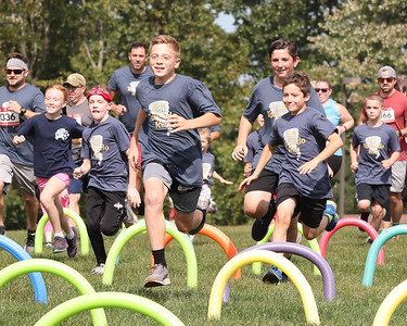 Runners tackle the first obstacle of the Tuff Tornado Run Saturday at Alemeda Park. Seb Foltz/Butle Eagle 10/02/21