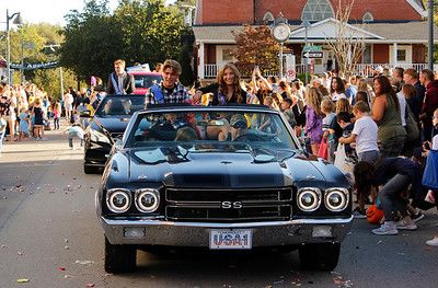 Homecoming Court students Eli Wright and Kalin Wilson toss candy to the crowd during the Mars Area School District Homecoming Parade. Julia Maruca/Butler Eagle