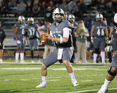 Slippery Rock quarterback Andrew Koester drops back to pass against Clarion Saturday. Seb Foltz/Butler Eagle 10/02/21