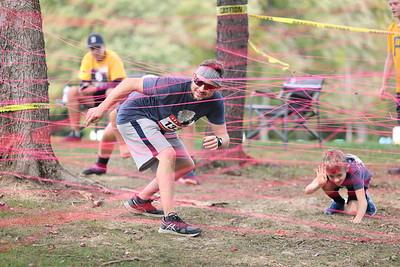 Seth Osche and his son Sebastian Osche make their way through the string maze in Saturday's Tuff Tornado Run at Alemeda Park. Seb Foltz/Butler Eagle 10/02/21
