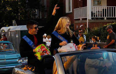 Homecoming Court students Madison Moan and Jacob Caringola toss candy to the crowd during the Mars Area School District Homecoming Parade. Julia Maruca/Butler Eagle