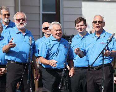 Members of the Greater Cranberry Men's Barbershop Chorus perform at Mars Apple Fest Saturday. Seb Foltz/Butler Eagle 10/02/21