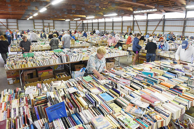 Nearly 100 people attended the book sale at the Butler Farm Show Wednesday order. Proceeds of the sale benefit the Butler County Federated Library System. Harold Aughton/Butler Eagle