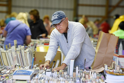 Retiree Dave Frengel of Connoquennessing Twp. browses through the thousands of books for sale at the Butler Farm Show Wednesday morning. Frengel is the former director of government affairs at Penn United. Proceeds of the sale benefit the Butler County Federated Library System. Harold Aughton/Butler Eagle