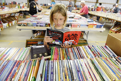 Josei Wilhite, 7, of Prospect attended the book sale at the Butler Farm Show grounds with her mother, Maggie Wilhite, Wednesday morning. Proceeds of the sale benefit the Butler County Federated Library Systems. Harold Aughton/Butler Ealge