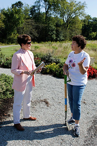 Rita Mack, right, co-president of the Southern Butler County Garden Club, tells Honora Rockar, left, of the Cranberry Township Environmental Advisory Committee about the club's work to plant pollinator-friendly flowers. Julia Maruca/Butler Eagle