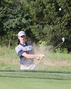 Butler junior Ryan Porch hits out of a bunker on hole no. 7 at Butler Country Club Thursday against Shaler. Seb Foltz/Butler Eagle 09/02/21