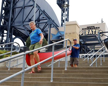 """""""River Angel"""" Trish Howison of McCandles helps Neal Moore carry his boat to the launch at PNC Park Aug. 31. Seb Foltz/Butler Eagle. 08/31/21"""