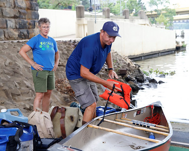 Neal Moore, 49, loads his canoe at the boat launch under the Clemente Bridge in Pittsburgh Aug. 31. Seb Foltz/Butler Eagle 08/31/21