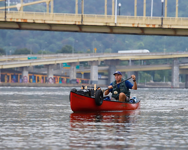 Cross-country canoer Neal Moore, 49, sets out from the  launch under the Clemente Bridge in Pittsburgh Aug. 31.  Moore's travels will take him from Oregon to New York up and down some of the nation's biggest waterways. He past through Pittsburgh on his way to East Brady Aug. 31.  Seb Foltz/Butler Eagle 08/31/21