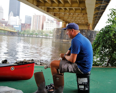 Neal Moore, 49, gets ready to launch his canoe at the boat launch under the Clemente Bridge in Pittsburgh Aug. 31. Seb Foltz/Butler Eagle 08/31/21
