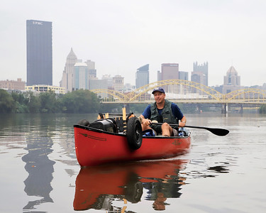 Cross-country canoer Neal Moore, 49, paddles north on the Allegheny River from downtown Pittsburgh Aug. 31.  When completed Moore's travels will take him from Oregon to New York up and down some of the nation's biggest waterways. After delays because of Tropical Storm Ida, Moore planned to reach East Brady Aug. 31.  Seb Foltz/Butler Eagle 08/31/21