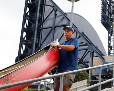 Neal Moore, 49, carries his canoe to the boat launch by PNC Park in Pittsburgh Aug. 31. Seb Foltz/Butler Eagle 08/31/21