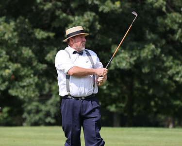 David Shultz watches his ball following a swing at Foxburg Country Club's hickory stick tournament Friday. Seb Foltz/Butler Eagle 08/13/21