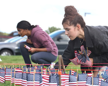 Mars JROTC junior Maddie Ostapchenko, 16, and  sophmore Reva Kalbhor,15, and  place flags with their fellow cadets to comemorate the victims of 9/11 at Mars High Schoo Thursdayl. Students placed a flag for each victim. Seb Foltz/Butler Eagle 09/09/21