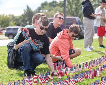 Mars JROTC senior Samuel Hagen, 17, and Pine Richland's Christian Bridge, 17 place flags with their fellow cadets to comemorate the victims of 9/11 at Mars High School Thursday. Students placed a flag for each victim. Seb Foltz/Butler Eagle 09/09/21
