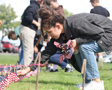 Mars JROTC junior Maddie Ostapchenko, 16,  places flags with her fellow cadets to comemorate the victims of 9/11 at Mars High School. Seb Foltz/Butler Eagle 09/09/21