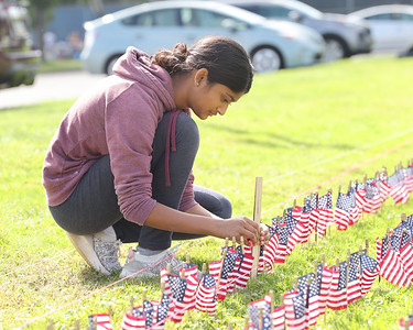 Mars JROTC sophmore Reva Kalbhor,15, measures flag heights while her fellow cadets place them to comemorate the victims of 9/11 at Mars High School Thursday. Students placed a flag for each victim. Seb Foltz/Butler Eagle 09/09/21