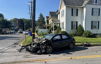 A car collided with a tractor trailer at West Main Street and Pattison Street in Evans City on Thursday morning. Julia Maruca/Butler Eagle