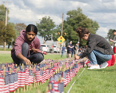 Mars JROTC sophmore Reva Kalbhor,15, and Maddie Ostapchenko, 16,  place flags with their fellow cadets to comemorate the victims of 9/11 at Mars High Schoo Thursdayl. Students placed a flag for each victim. Seb Foltz/Butler Eagle 09/09/21