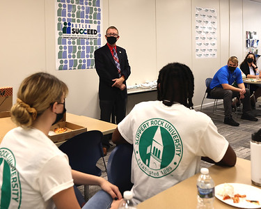 Butler Downtown president Jeff Geibel talks to student volunteers in Slippery Rock Universities new Butler Succeed building on Main Street. The new facility will be home to the schools community engagement programs. Seb Foltz/Butler Eagle 09/10/21