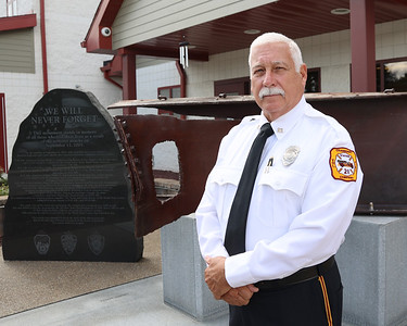Cranberry Township Fire Department's Jeff Berneburg in front of the department's 9/11 Memorial. Seb Foltz/Butler Eagle 09/09/21