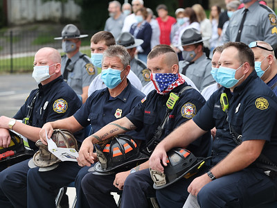 Butler City fire fighters Jeff Scott, Thomas Fair, Tim Iman  and Floyd Lohr sit among first  responders honored at Butler Catholic's 9/11 memorial Friday. Seb Foltz/Butler Eagle 09/10/21