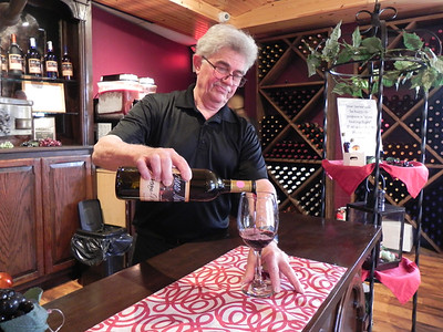 Lorenz Werhame pours a bottle of red wine at Anna Marie's Winery and Cafe, which is participating in Butler County restaurant week.EDDIE TRIZZINO/BUTLER EAGLE