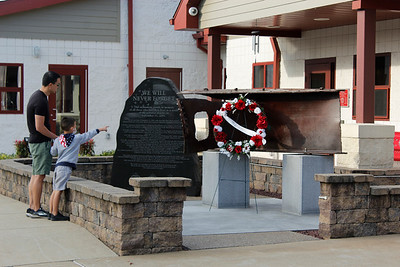 Norman and Roman Seto of Mars pay their respects to the 9/11 memorial at the Cranberry Township Volunteer Fire Department station on Saturday morning. Julia Maruca/Butler Eagle