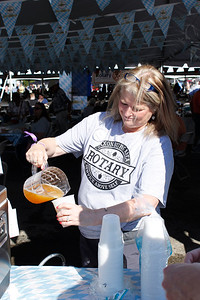Wendy Mccall, a volunteer with the Saxonburg Rotary, pours a beer at Sprankle's Octoberfest. Julia Maruca/Butler Eagle