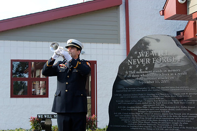 John Pristas, Cranberry Township Volunteer Fire Company Assistant Chief, plays Taps in honor of 9/11 victims. Julia Maruca/Butler Eagle