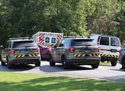State Police cruisers surround an ambulance containing Saturday's shooting suspect near West Liberty. Seb Foltz/Butler Eagle 09/11/21