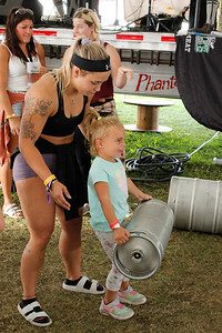 Bria Otwell of Crossfit Saxonburg helps 4-year-old Nina Ceccheti lift a keg as part of the keg clean-and-press contest. Julia Maruca/Butler Eagle