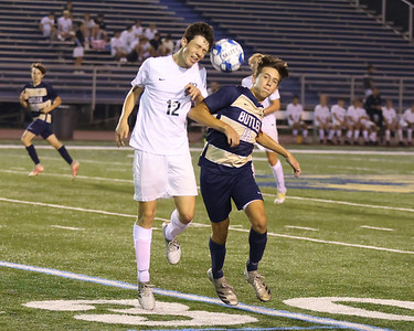 Butler's Carson Knight wins a contested ball against Pine Richland's Tyler Fritz. Seb Foltz/Butler Eagle 09/13/21