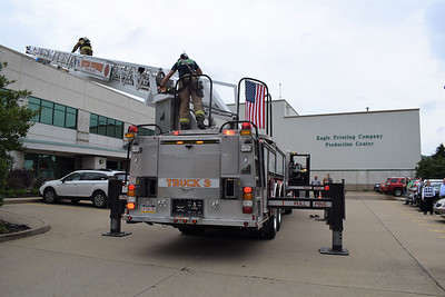Butler Eagle employees evacuated the building at 514 W. Wayne St. Wednesday morning while three area fire departments investigated smoke in an upstairs hallway of the two-story building. Tracy Leturgey/Butler Eagle