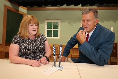 Juror 4, Nedra Casey and Juror 8, Rik Medic act out a scene comparing evidence during a dress rehearsal of 12 Angry Men at the Butler Little Theatre Wednesday. Seb Foltz/Butler Eagle 09/15/21