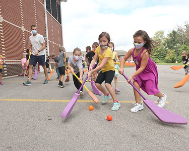 Pittsburgh Penguins defender Brian Dumoulin (back) plays foam hockey with Knoch Elementary students during a visit to the school Thursday. The visit was part of an academic achievement reward for students in the elementary and middle School. Seb Foltz/Butler Eagle 09/16/21