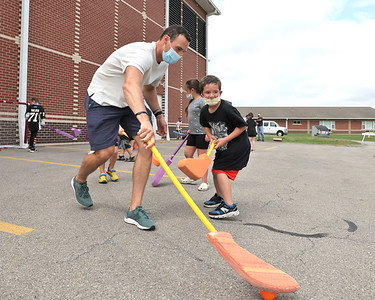 Pittsburgh Penguins defender Brian Dumoulin plays foam hockey with Knoch Elementary students during a visit to the school Thursday. The visit was part of an academic achievement reward for students in the elementary and middle School. Seb Foltz/Butler Eagle 09/16/21