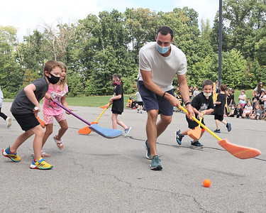 Pittsburgh Penguins defender Brian Dumoulin plays keep away with Knoch Elementary School students during a visit to the school Thursday. The visit was part of an academic achievement reward for students in the elementary and middle School. Seb Foltz/Butler Eagle