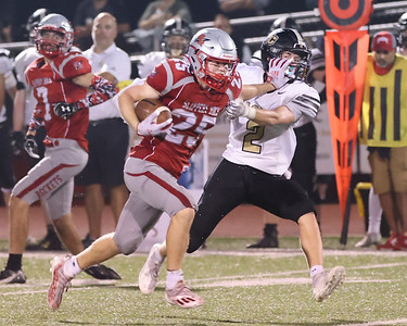 Slippery Rock's Ryan Montgomery stiff arms Grove City's Joey Hathaway on a third quarter play for a long gain in the Rockets 37-7 home win Friday. Seb Foltz/Butler Eagle 09/17/21