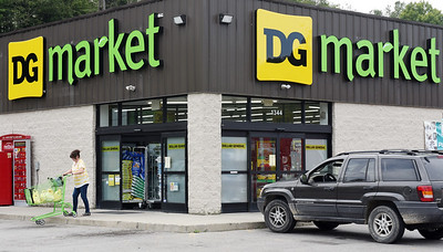 Pat Christie of Chicora leaves the new DG Market formerly the Dollar General Store in Chicora. The bargain retail store carries a variety of household goods, groceries as well as fresh produce and meats.  Harold Aughton/Butler Eagle