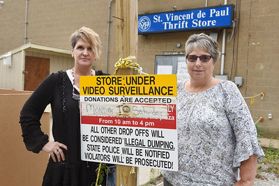 Amy Watson and Lisa Slupe of St. Vincent de Paul Thrift Store have caught people on surveillance cameras dumping trash not treasures at the St. Vincent de Paul Society store at Greater Butler Mart.  Harold Aughton/Butler Eagle
