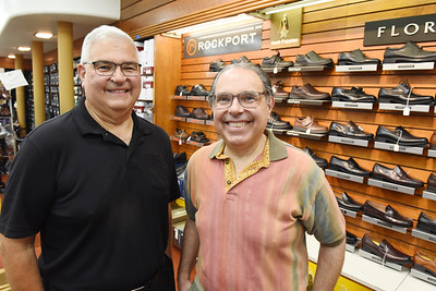 Brothers Jimmy, left and Tony Chiprean of Miller's Shoes recently reopened after their store sustained smoke and water damage from a fire in an adjacent building. Harold Aughton/Butler Eagle