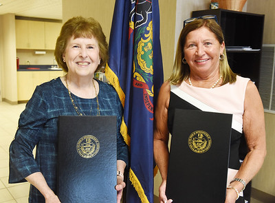 Representative Marci Mustello presented memorial citations to Bonnie Travaglio, left, and Joan Steighner during a ceremony in recognition of their late husbands Rep. Guy Travaglio and Rep. Joe Steighner Thursday afternoon. Harold Aughton/Butler Eagle