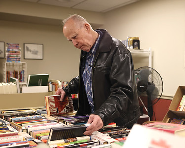 Bill Daw of Slippery Rock browses for books at the Friends of the Library book sale Thursday at the ButlerArea Public Library. The nonprofit group hosts a book sale in a room at the library every Monday and Thursday with donated books and books no longer in the library's circulation. All paperbacks are $0.50, hardcovers $1.00. Proceeds benefit the library. Used books for the sale can be donated to the library at any time. Seb Foltz/Butler Eagle 09/23/21